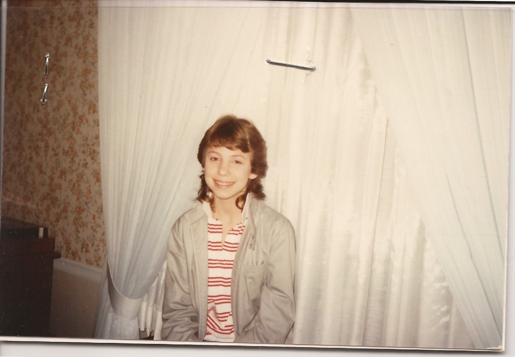Photo of Leslie in 7th grade wearing a Members Only jacket and sporting a mullet.
