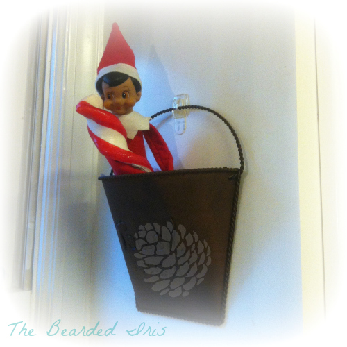 Dobbie The Inappropriate Elf on the Shelf licking a large turgid candy cane by The Bearded Iris