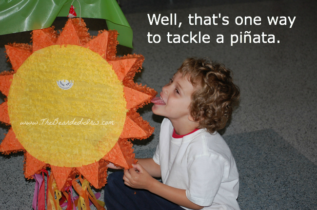 bucket head licks a piñata