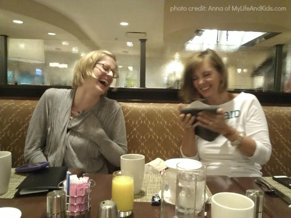 Kim Bongiorno and Kerry Rossow laughing at BlogHer13