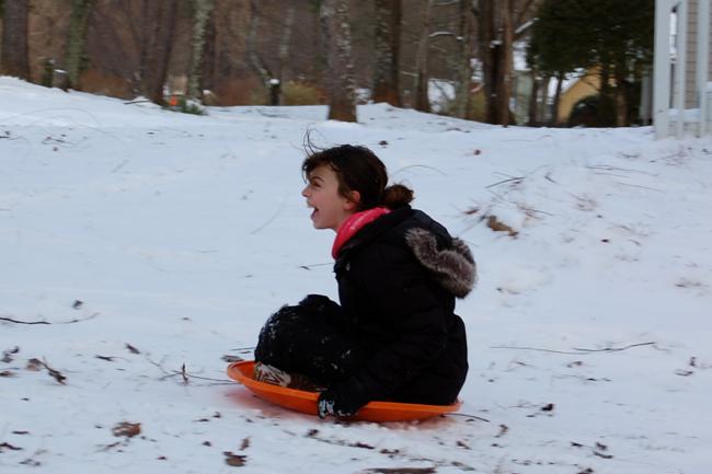 Mini-Me sledding